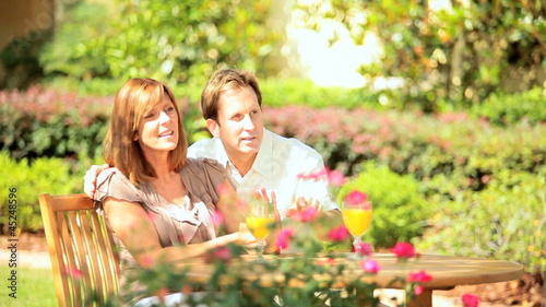 Contented Couple Sitting Home Garden