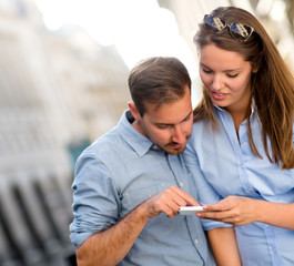 Couple using a GPS device