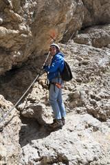 female hiker on via ferrata