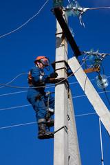 Electric rises to concrete pole