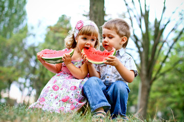 Two pretty kids with watermelon