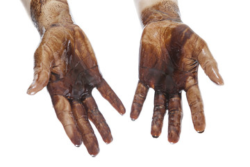 Human hands stained with black petroleum isolated on white