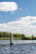 Poles in river