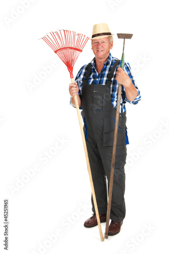 senior gardener with equipment