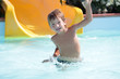 young happy child boy having fun in aquapark