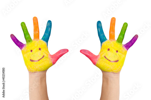 two hands with smile painted different colors of child as logo