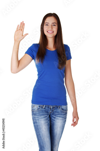 Happy teenage girl waving a greeting