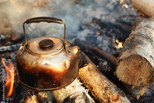 sooty teapot on camping bonfire