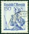 stamp printed in Austria, shows a woman in national dress