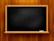 Blackboard On Wooden Backgroun...