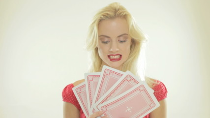 Blonde woman holding playing cards