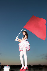 The young woman with a red flag