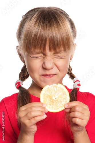 Little girl with lemon