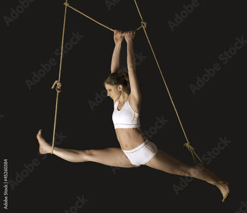 Young woman gymnast.