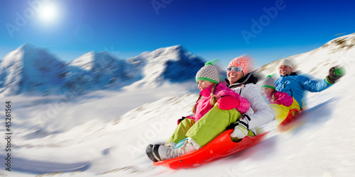 Winter, snow, family sledding at winter time - 45261564