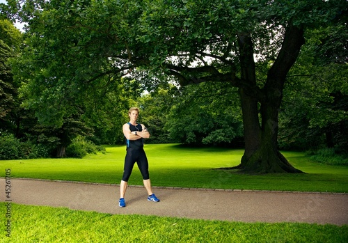 Athlete Posing with Trees in the Background
