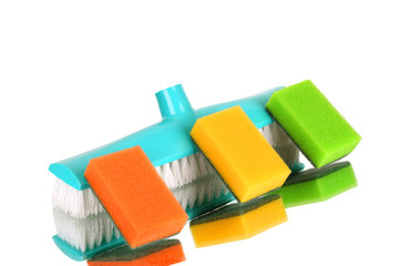 brush for a floor and a sponge on a white background