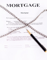 Mortgage. Contract entwined chain and pen