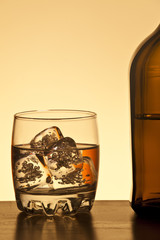 Glass and botlle of rum