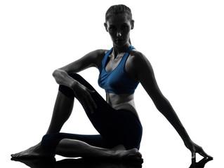 woman exercising yoga sitting stretching