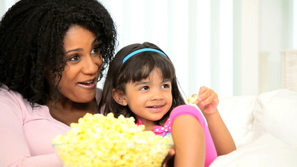 Young Ethnic Mother Daughter Eating Popcorn
