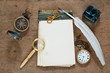 Old notebook, compass, watch, quill, inkwell, magnifying glass