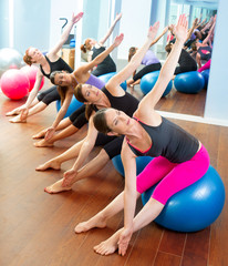 Pilates aerobic women group with stability ball