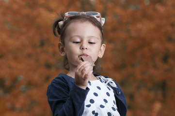 Young girl eating a chocolate