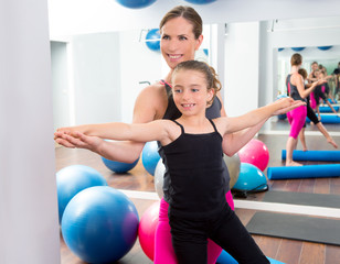 Aerobics woman personal trainer of children girl
