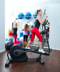 Aerobics cardio training woman on elliptic crosstrainer