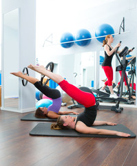 Aerobics pilates gym women group and crosstrainer