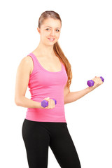 Active young female lifting weights