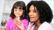 Pretty Ethnic Mom Daughter Using Cosmetics