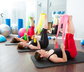 Aerobics pilates women with rubber bands in a row
