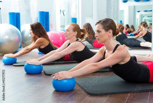 Aerobics pilates women with yoga balls