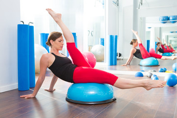 Bosu ball for fitness instructor woman in aerobics