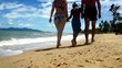 Family go for a walking along sand beach