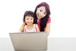 A mother accompany her child to use internet