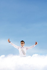 Successful businessman on the cloud