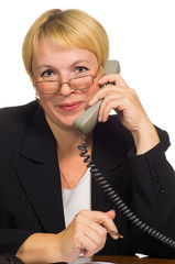 Mature businesswoman calling on the phone at her workplace