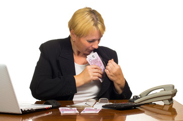 Mature businesswoman hides money