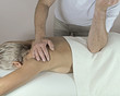 Male Therapist applying pressure with Elbow