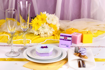 Serving fabulous wedding table in purple and yellow color