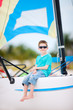 Cute boy at on catamaran