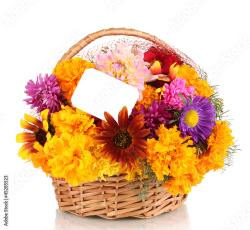 Beautiful bouquet of bright flowers in basket with paper note