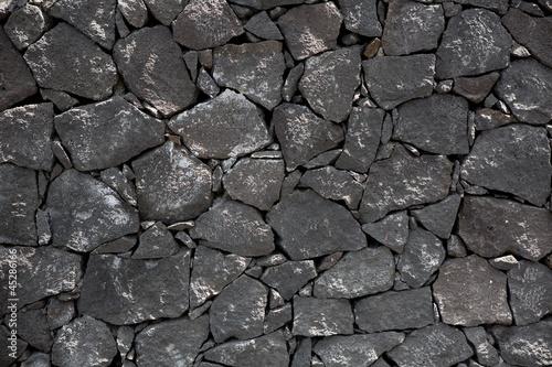 Black lava stone volcanic masonry wall