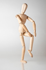 wooden man with knee ache