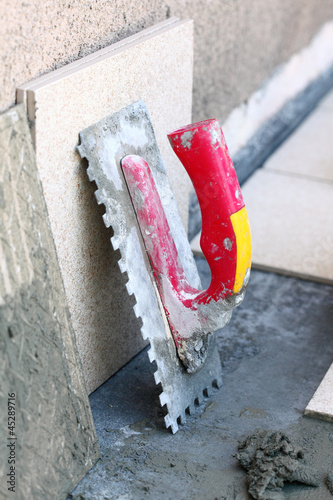 mortar on wall construction notched trowel Poster