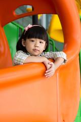 Child plays slide at playground