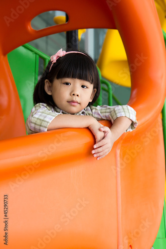 Child plays slide at playground